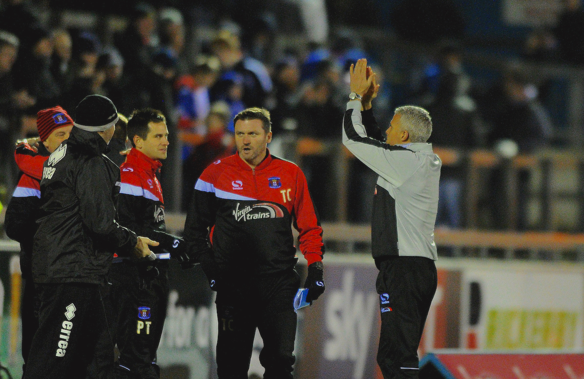 Carlisle United manager Keith Curle (right) applauds the fans after the final whistle of the Sky Bet League 2 match at Brunton Park, Carlisle Picture by Greg Kwasnik/Focus Images Ltd +44 7902 021456 20/12/2014