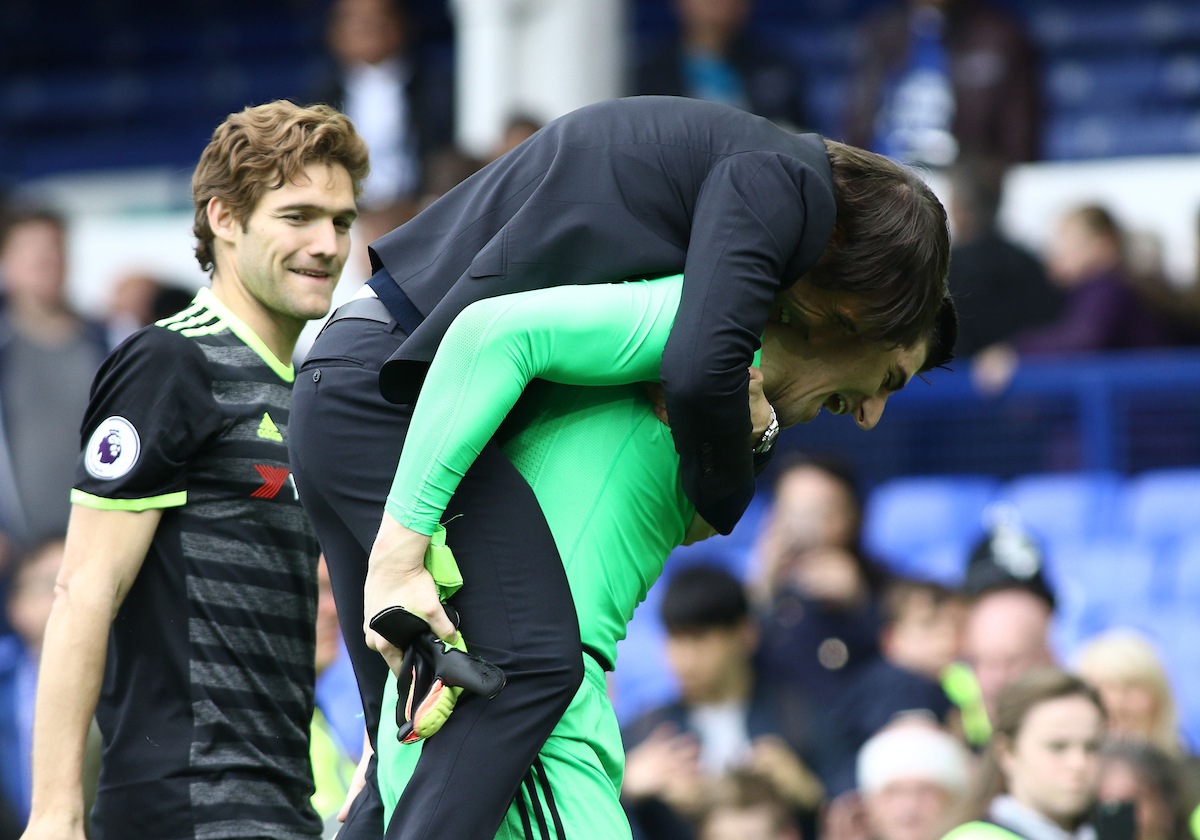 Antonio Conte, manager of Chelsea celebrates his teams win by jumping upon the back of goalkeeper Thibaut Courtois after the Premier League match against Everton at Goodison Park, Liverpool. Picture by Michael Sedgwick/Focus Images Ltd +44 7900 363072 30/04/2017