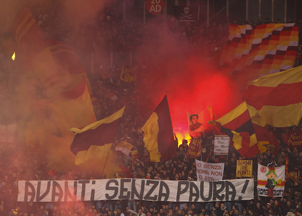 Fans of A.S. Roma wave flags and set flares alight during the UEFA Champions League match at the Stadio Olimpico, Rome Picture by John Rainford/Focus Images Ltd +44 7506 538356 10/12/2014