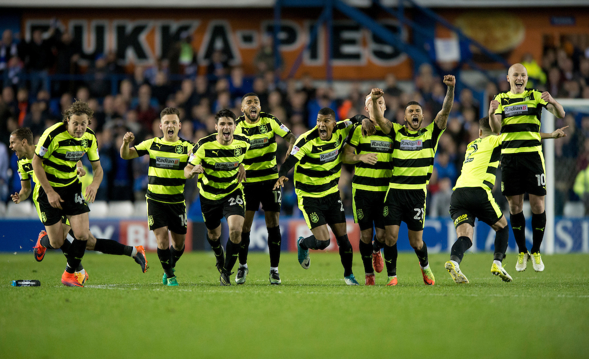 Huddersfield Town players celebrate after their team reach the play-off final during second leg of the Sky Bet Championship Semi-final Play-off at Hillsborough, Sheffield Picture by Russell Hart/Focus Images Ltd 07791 688 420 17/05/2017