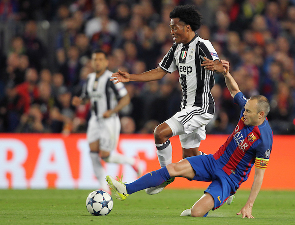 Andres Iniesta of FC Barcelona tackles Juan Cuadrado of Juventus during the UEFA Champions League match at Camp Nou, Barcelona Picture by Stefano Gnech/Focus Images Ltd +39 333 1641678 19/04/2017