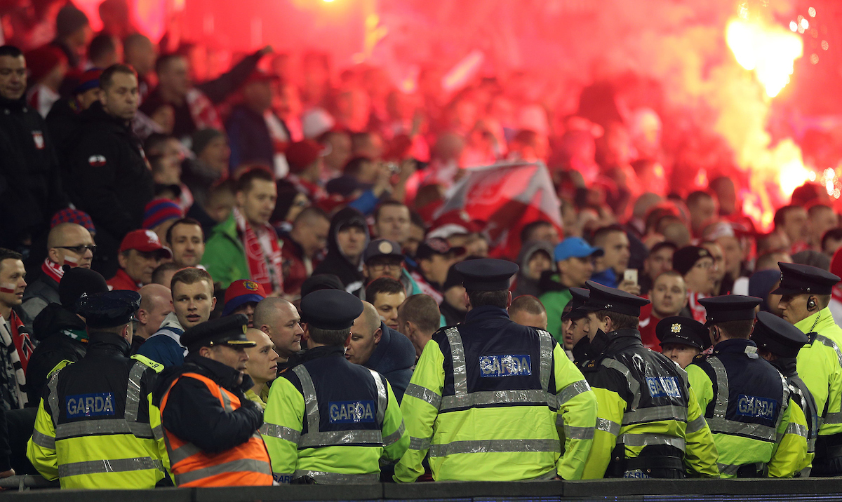 Police keep an eye on Polish fans during the UEFA Euro 2016 Qualifying match at the Aviva Stadium, Dublin Picture by Lorraine O'Sullivan/Focus Images Ltd +353 872341584 29/03/2015