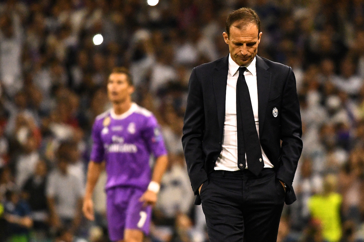 Juventus manager Massimiliano Allegri reacts as Cristiano Ronaldo of Real Madrid (left) celebrates scoring their third goal to make it Real Madrid 3 Juventus 1 during the UEFA Champions League Final at the Principality Stadium, Cardiff Picture by Kristian Kane/Focus Images Ltd +44 7814 482222 03/06/2017