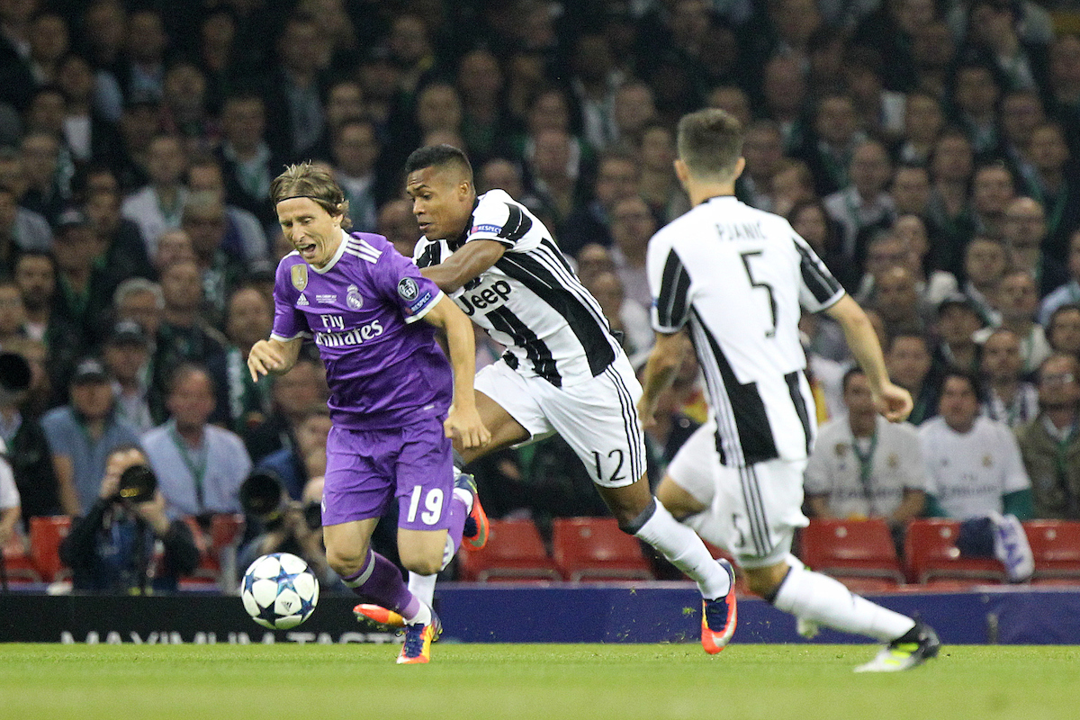 Alex Sandro of Juventus and Luka Modric of Real Madrid in action during the UEFA Champions League Final at the Principality Stadium, Cardiff Picture by Paul Chesterton/Focus Images Ltd +44 7904 640267 03/06/2017