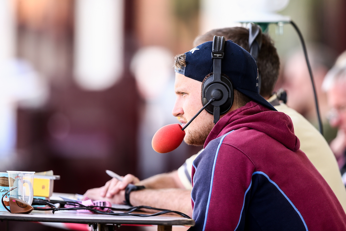 Josh Cobb of Northamptonshire CCC joins a radio commentary team during the Specsavers County C'ship Div Two match at the County Ground, Northampton Picture by Andy Kearns/Focus Images Ltd 0781 864 4264 16/08/2016