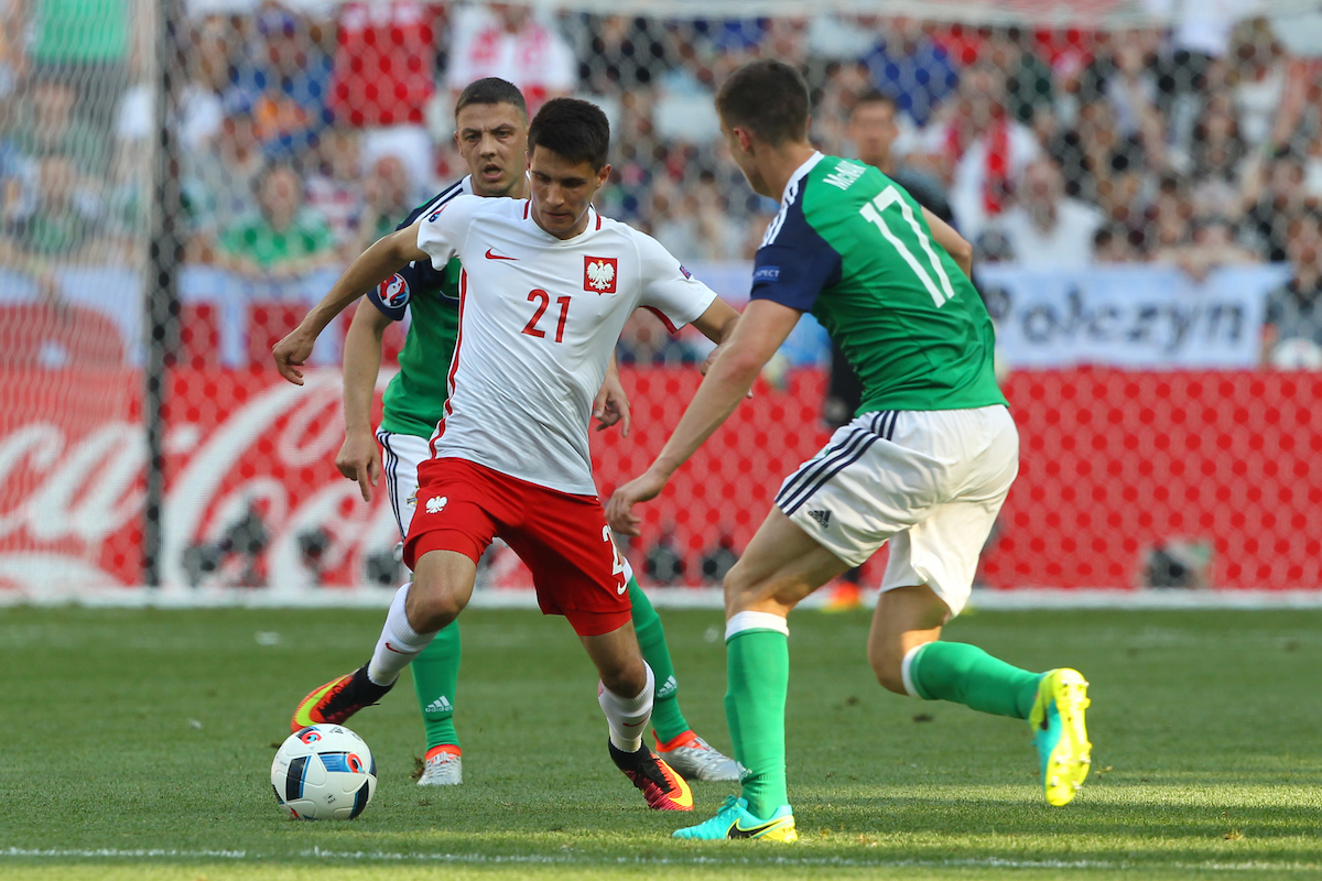 Bartosz Kapustka of Poland and Paddy McNair of Northern Ireland in action during the UEFA Euro 2016 match at Stade de Nice, Nice Picture by Paul Chesterton/Focus Images Ltd +44 7904 640267 12/06/2016