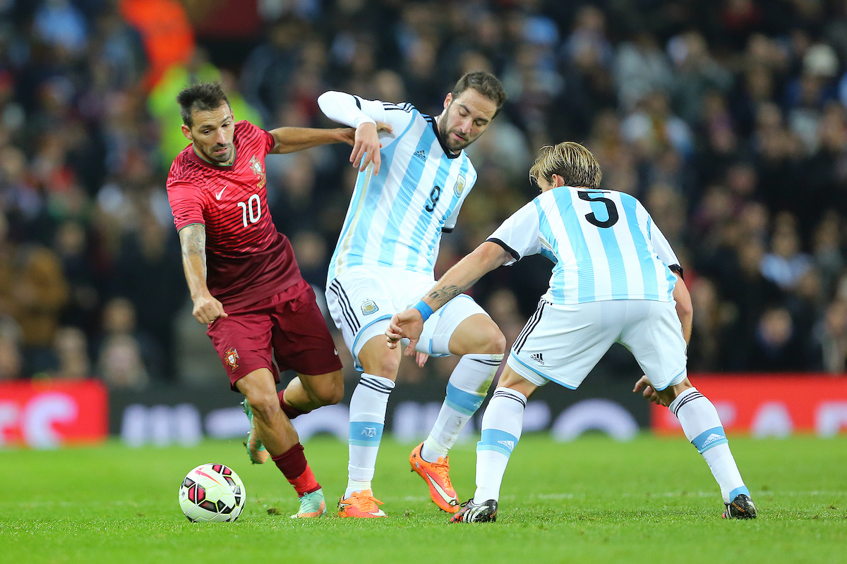 Danny of Portugal skips past Lucas Biglia (right) and Gonzalo Higuain (centre) during the International Friendly match at Old Trafford, Manchester Picture by Richard Calver/Focus Images Ltd +447792 981244 18/11/2014