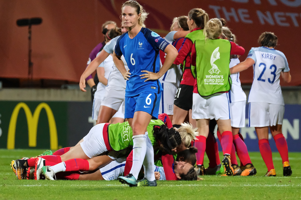 Amandine Henry of France looks on as England players celebrate after Jodie Taylor's goal gives England a 1-0 victory over France following the UEFA Women's Euros 2017 quarter-final match at De Adelaarshorst, Deventer Picture by Kristian Kane/Focus Images Ltd +44 7814 482222 30/07/2017