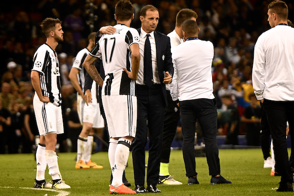Juventus manager Massimiliano Allegri consoles Mario Mandžuki? of Juventus following the UEFA Champions League Final at the Principality Stadium, Cardiff Picture by Kristian Kane/Focus Images Ltd +44 7814 482222 03/06/2017