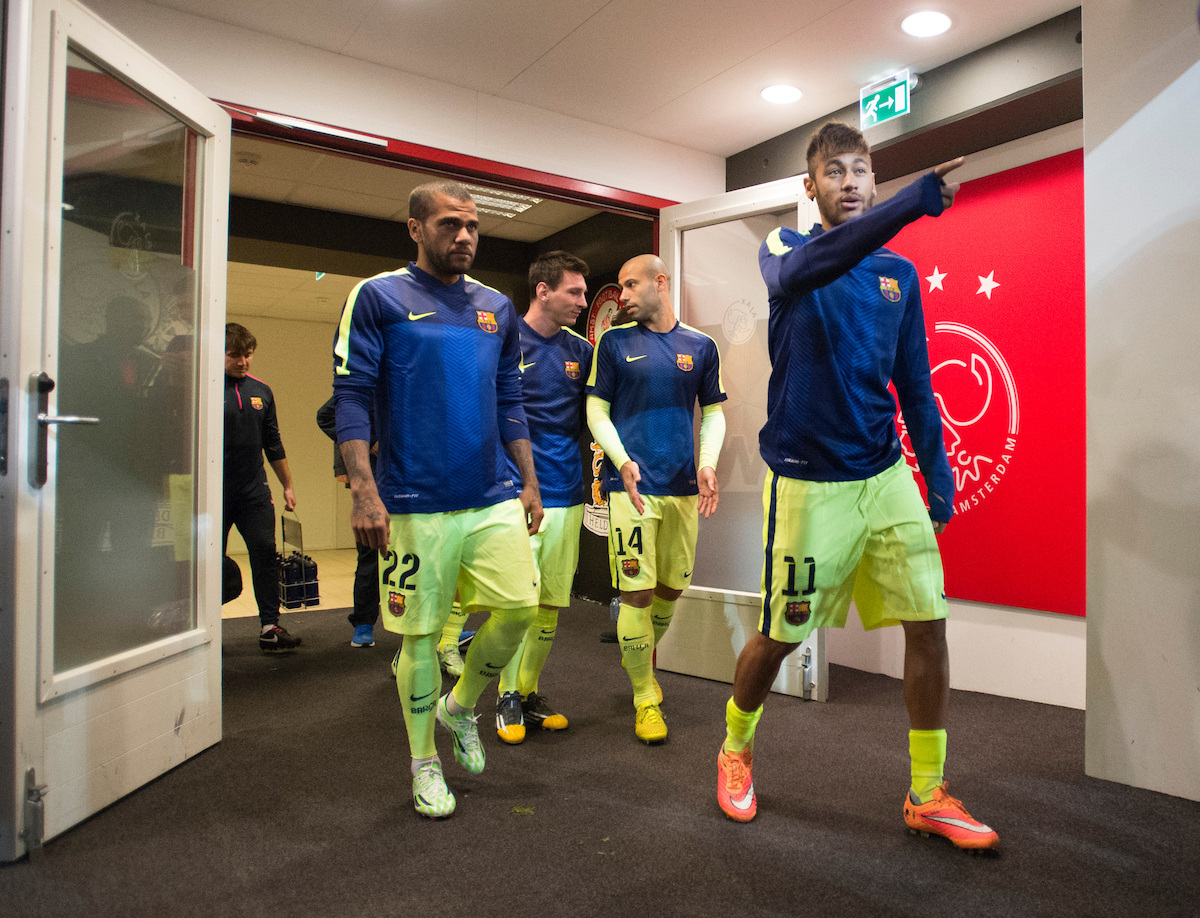 FC Barcelona players Neymar (11), Daniel Alves (22), Javier Mascherano (14), and Lionel Messi (10 - number hidden) make their way to the playing area before the UEFA Champions League match at Amsterdam Arena, Amsterdam Picture by Russell Hart/Focus Images Ltd 07791 688 420 05/11/2014