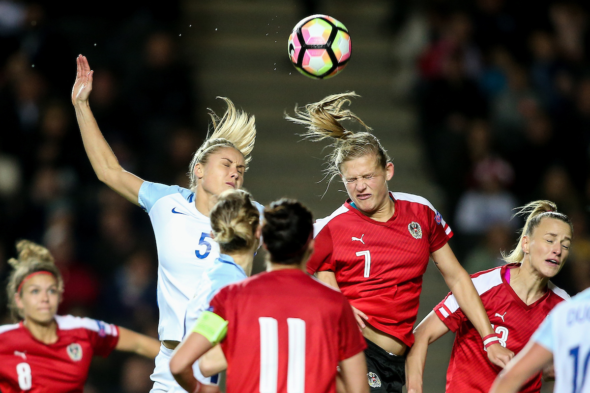 Steph Houghton of England Women (left) competing with Carina Wenninger of Austria Women (right) during the International Friendly match at stadium:mk, Milton Keynes Picture by Andy Kearns/Focus Images Ltd 0781 864 4264 10/04/2017