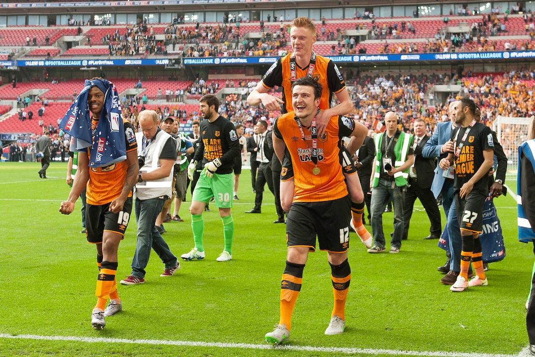 Harry Maguire of Hull City celebrates with Sam Clucas of Hull City during the Sky Bet Championship Play-off Final between Hull City and Sheffield Wednesday at KC Stadium, Hull Picture by Richard Blaxall/Focus Images Ltd +44 7853 364624 28/05/2016