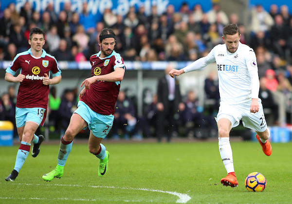Gylfi Sigurdsson of Swansea City and George Boyd of Burnley during the Premier League match at the Liberty Stadium, Swansea Picture by Mike Griffiths/Focus Images Ltd +44 7766 223933 04/03/2017