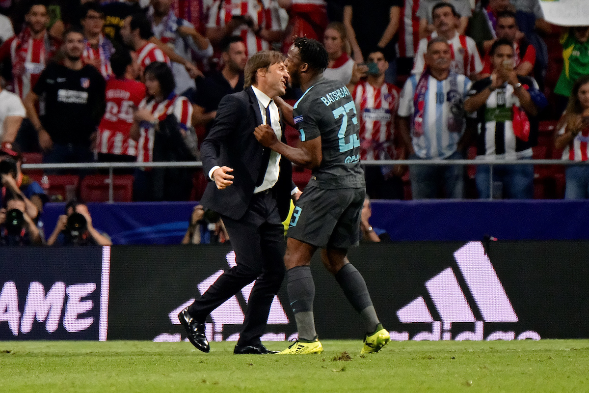 Michy Batshuayi of Chelsea celebrates with Chelsea manager Antonio Conte after scoring their second goal to make it Atletico Madrid 1 Chelsea 2 to leave Diego Godín of Atletico Madrid and their fans deflated during the UEFA Champions League match at the Wanda Metropolitano Stadium, Madrid Picture by Kristian Kane/Focus Images Ltd +44 7814 482222 27/09/2017