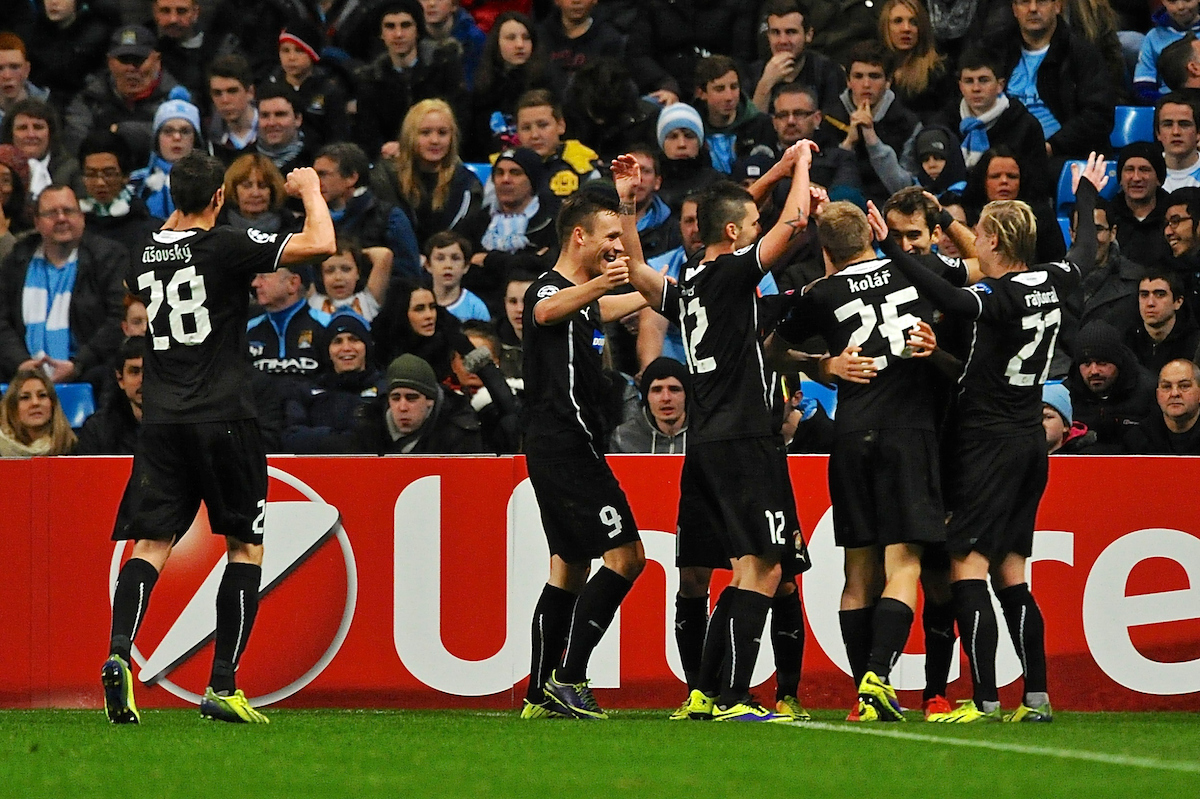 Picture by Ian Wadkins/Focus Images Ltd +44 7877 568959 27/11/2013 Viktoria Plze? players celebrate after Milan Petržela scores to make it 1-1 during the UEFA Champions League match at the Etihad Stadium, Manchester.