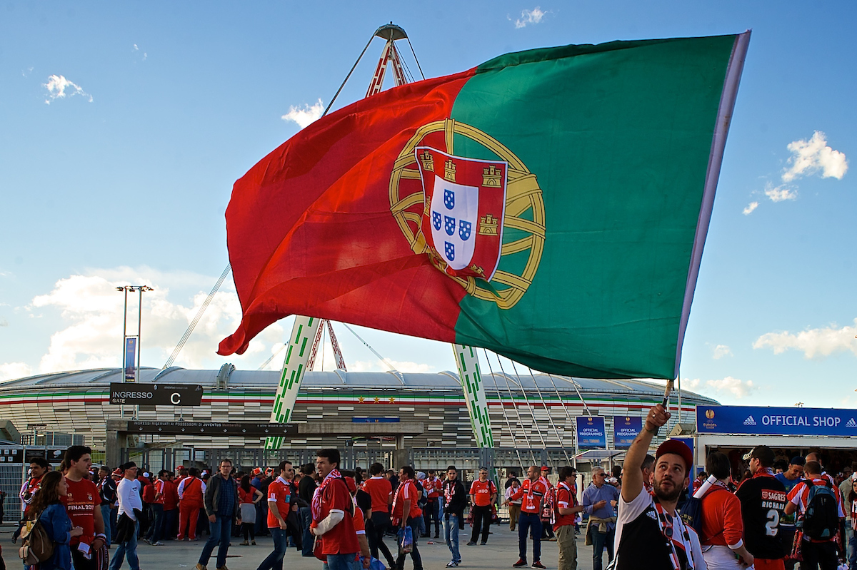 General view of the exterior of the stadium showing a Benfica fan holding a Portugal flag pictured ahead of the UEFA Europa League match at Juventus Stadium, Turin Picture by Ian Wadkins/Focus Images Ltd +44 7877 568959 14/05/2014