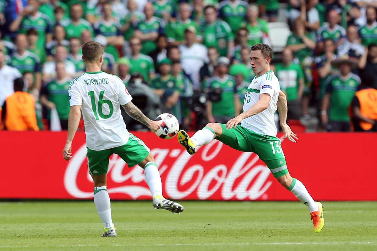 Corry Evans of Northern Ireland and Oliver Norwood of Northern Ireland during the UEFA Euro 2016 match at Parc des Princes, Paris Picture by Paul Chesterton/Focus Images Ltd +44 7904 640267 25/06/2016