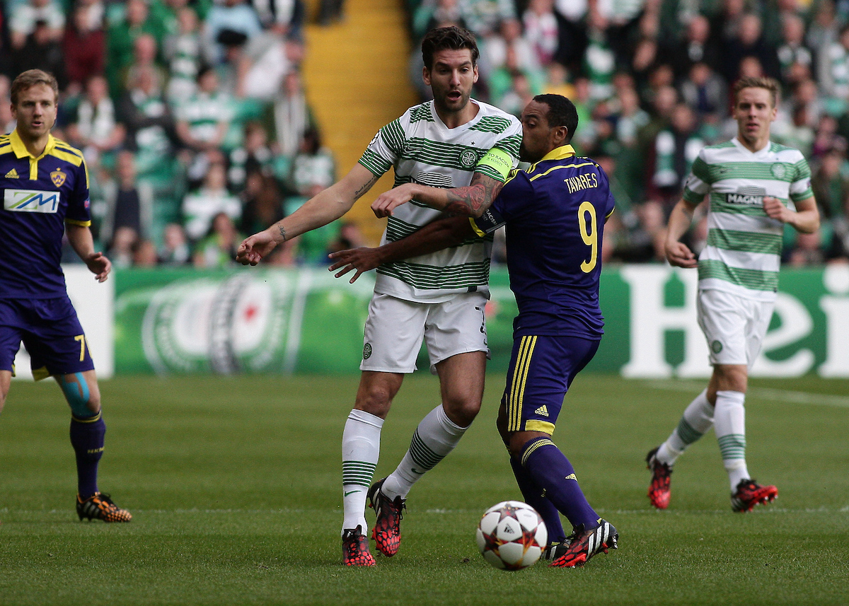 Charlie Mulgrew of Celtic and Tavares of NK Maribor during the UEFA Champions League Qualifier Play Off Second Leg match at Celtic Park, Glasgow Picture by Ian Buchan/Focus Images Ltd +44 7895 982640 26/08/2014