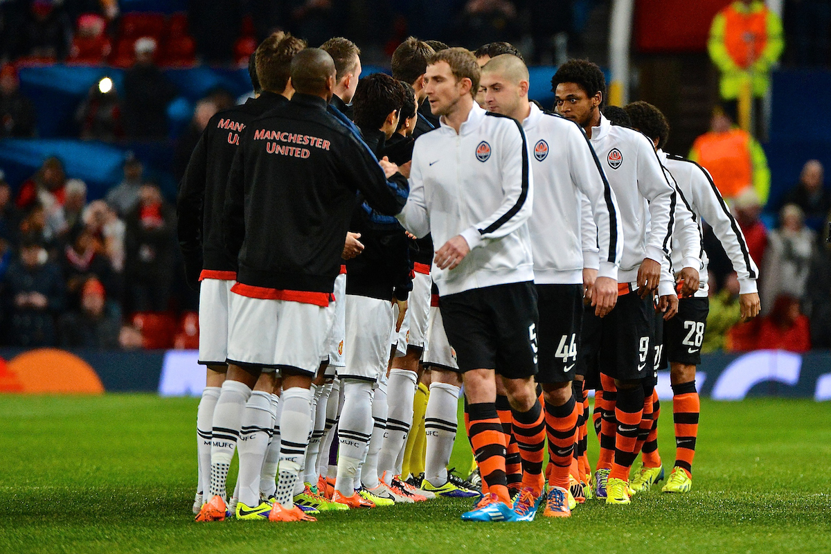 Picture by Ian Wadkins/Focus Images Ltd +44 7877 568959 10/12/2013 General view showing Manchester United and Shakhtar Donetsk players shaking hands ahead of the UEFA Champions League match at Old Trafford, Manchester.