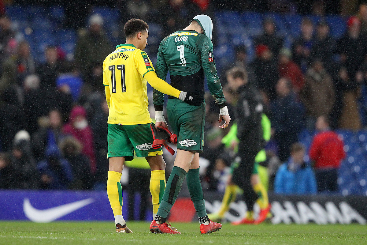 Josh Murphy of Norwich consoles Angus Gunn of Norwich at the end of the Third Round FA Cup Replay match at Stamford Bridge, London Picture by Paul Chesterton/Focus Images Ltd +44 7904 640267 17/01/2018
