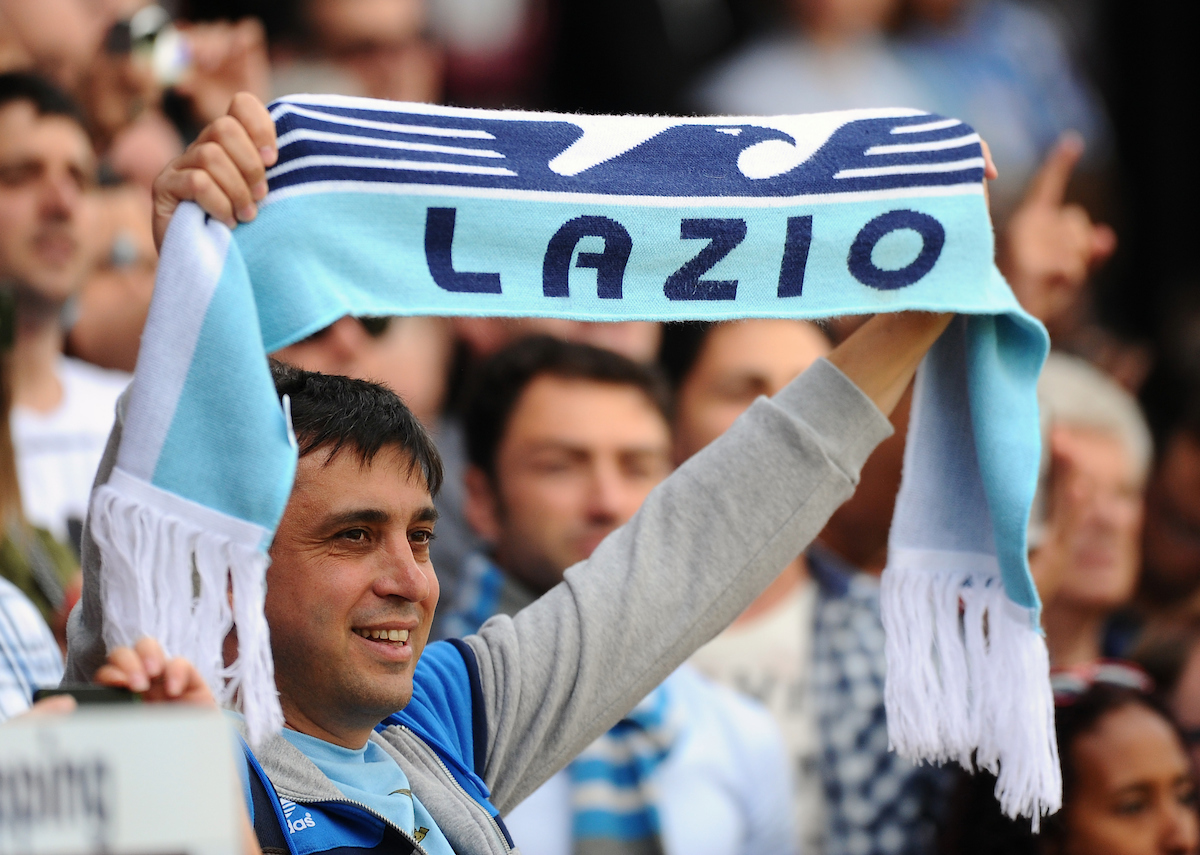 Picture by Seb Daly/Focus Images Ltd +447738 614630 10/08/2013 A Lazio fan holds up his team scarf during the Pre Season Friendly match at Selhurst Park, London.