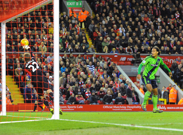 Liverpool goalkeeper Simon Mignolet saves a header by Virgil van Dijk of Southampton (right) during the Barclays Premier League match at Anfield, Liverpool Picture by Greg Kwasnik/Focus Images Ltd +44 7902 021456 24/10/2015