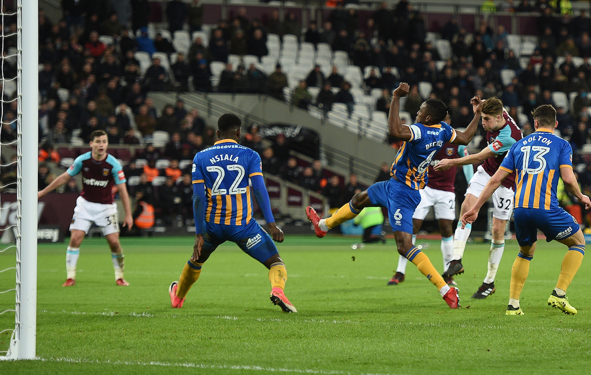 West Ham United's Reece Burke scores his side's first goal of the game during the Third Round FA Cup Replay match at the London Stadium, Stratford Picture by Daniel Hambury/Focus Images Ltd 07813022858 16/01/2018