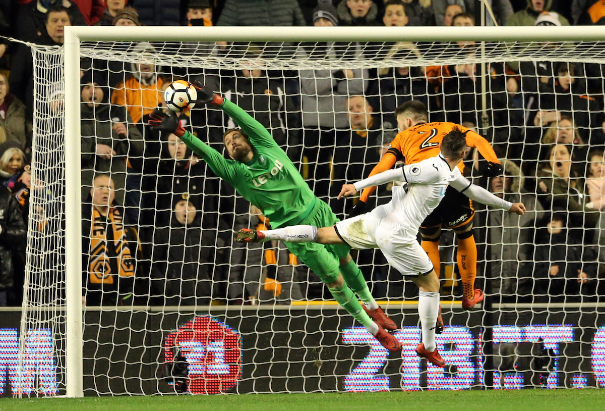 Matt Doherty (2) of Wolverhampton Wanderers has a header saved by Kristoffer Nordfeldt (l) of Swansea City during the Third Round FA Cup match at Molineux, Wolverhampton Picture by Simon Moore/Focus Images Ltd 07807 671782 06/01/2018