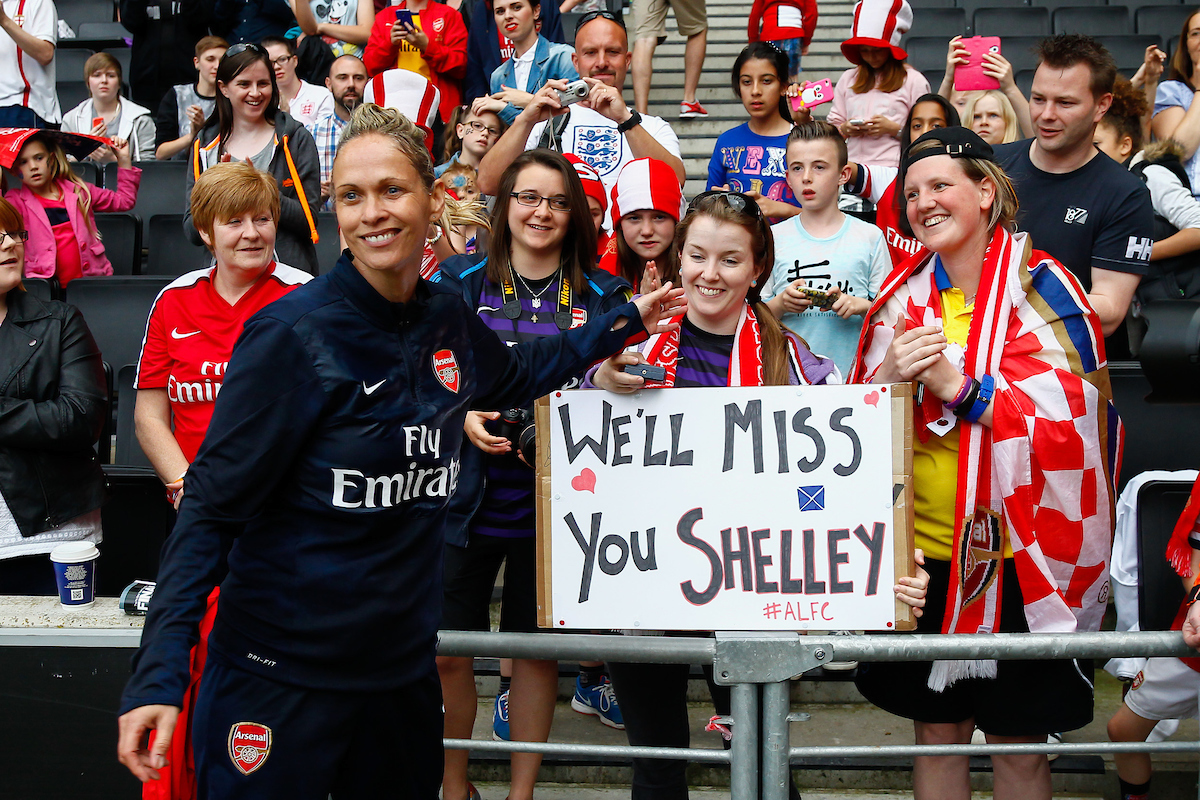 Shelley Kerr Head Coach of Arsenal L.F.C. hands her winner's medal to a fan holding a banner in her honour after the FA Women's Cup Final match at stadium:mk, Milton Keynes Picture by David Horn/Focus Images Ltd +44 7545 970036 01/06/2014