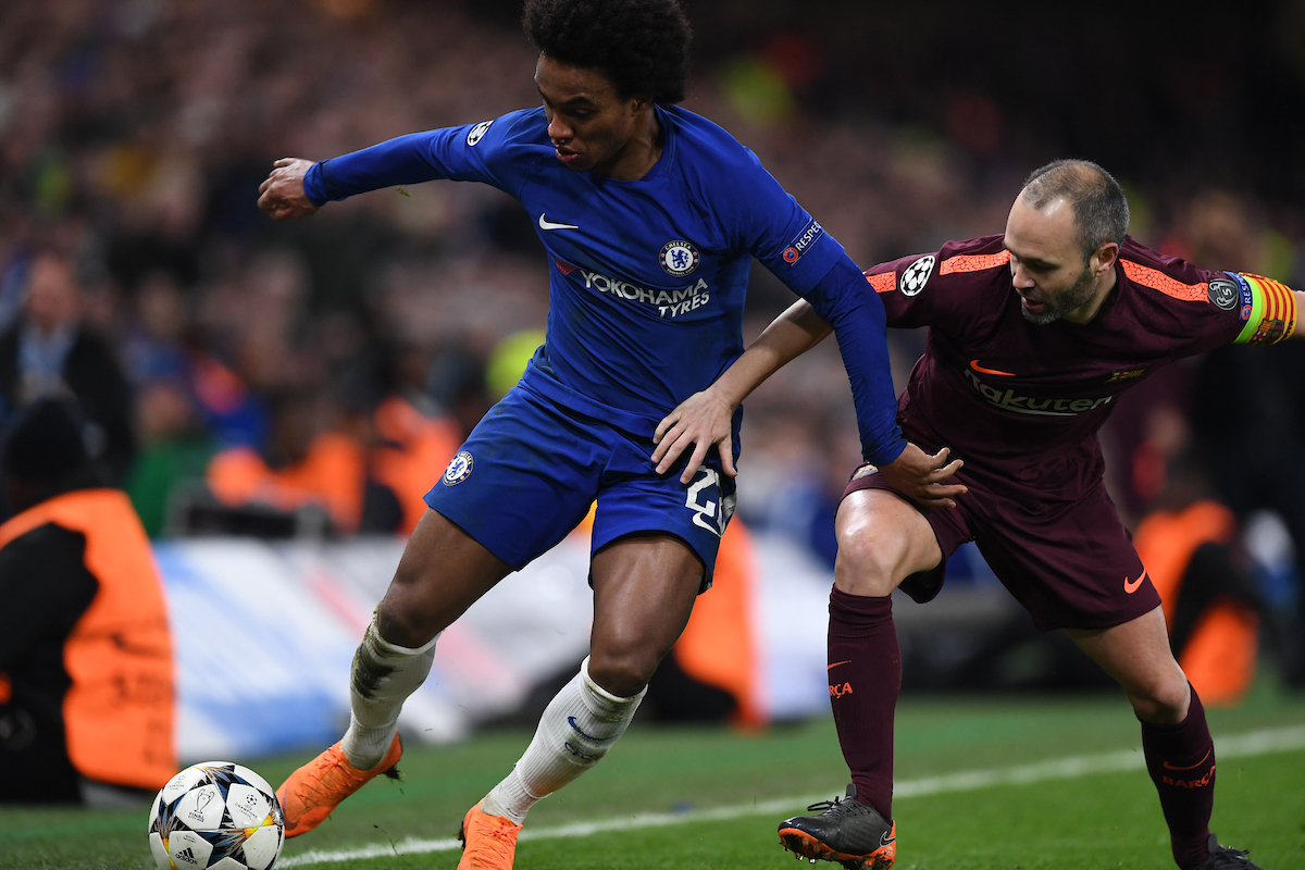 Willian of Chelsea and Andrés Iniesta of FC Barcelona battle for the ball during the UEFA Champions League match at Stamford Bridge, London Picture by Simon Dael/Focus Images Ltd 07866 555979 20/02/2018