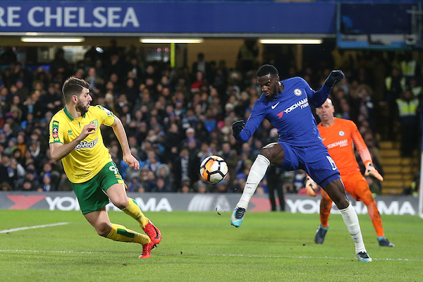 Tiemoue Bakayoko of Chelsea reacts to the rebound from James Maddison of Norwich's shot before Nelson Oliveira of Norwich in action during the Third Round FA Cup Replay match at Stamford Bridge, London Picture by Paul Chesterton/Focus Images Ltd +44 7904 640267 17/01/2018