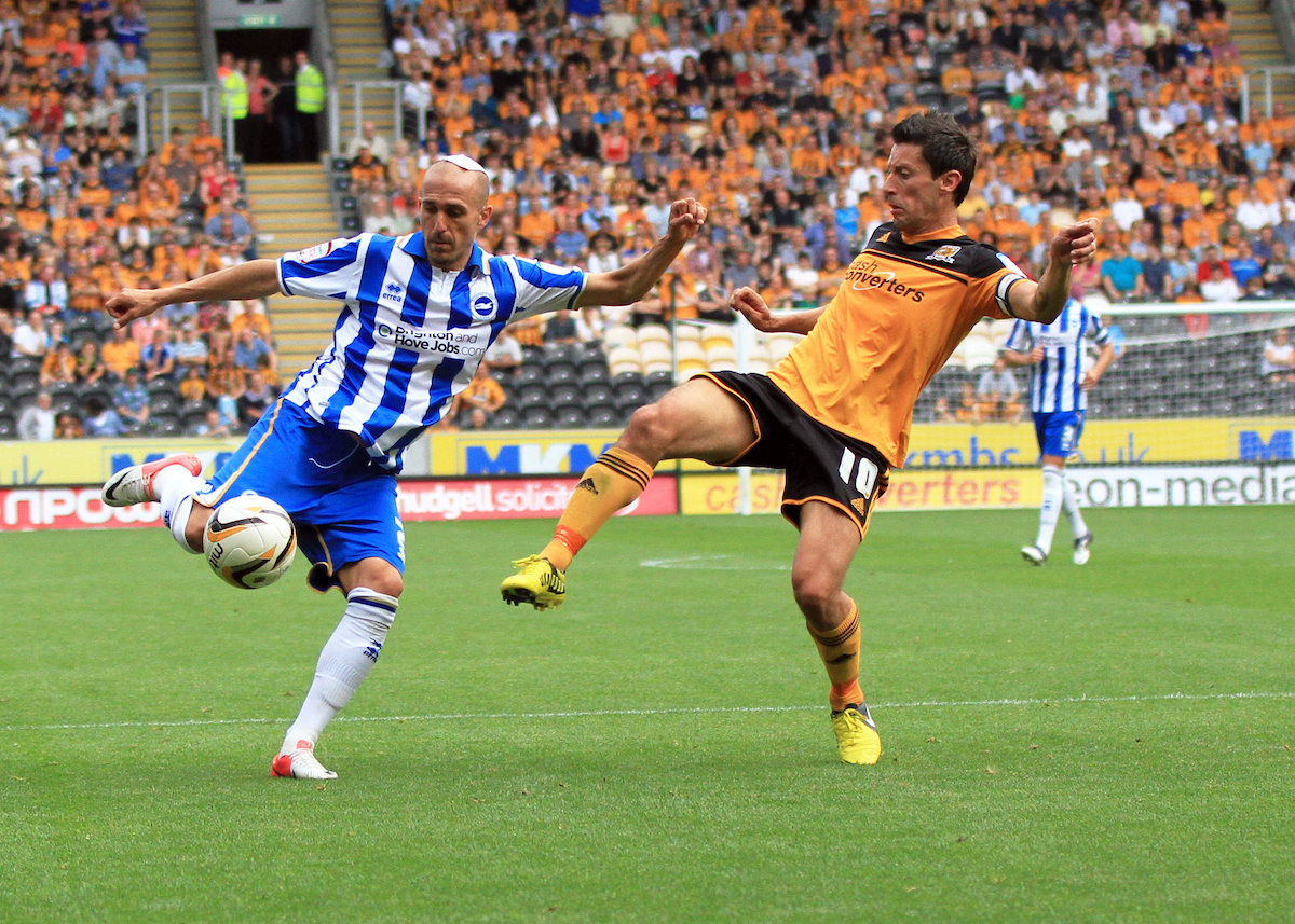 Picture by Richard Gould/Focus Images Ltd +44 7855 403186.18/08/2012.Robert Koren (R) of Hull City and Bruno Saltor (L) of Brighton and Hove Albion in action during the Barclays Premier League match at the KC Stadium, Kingston upon Hull.