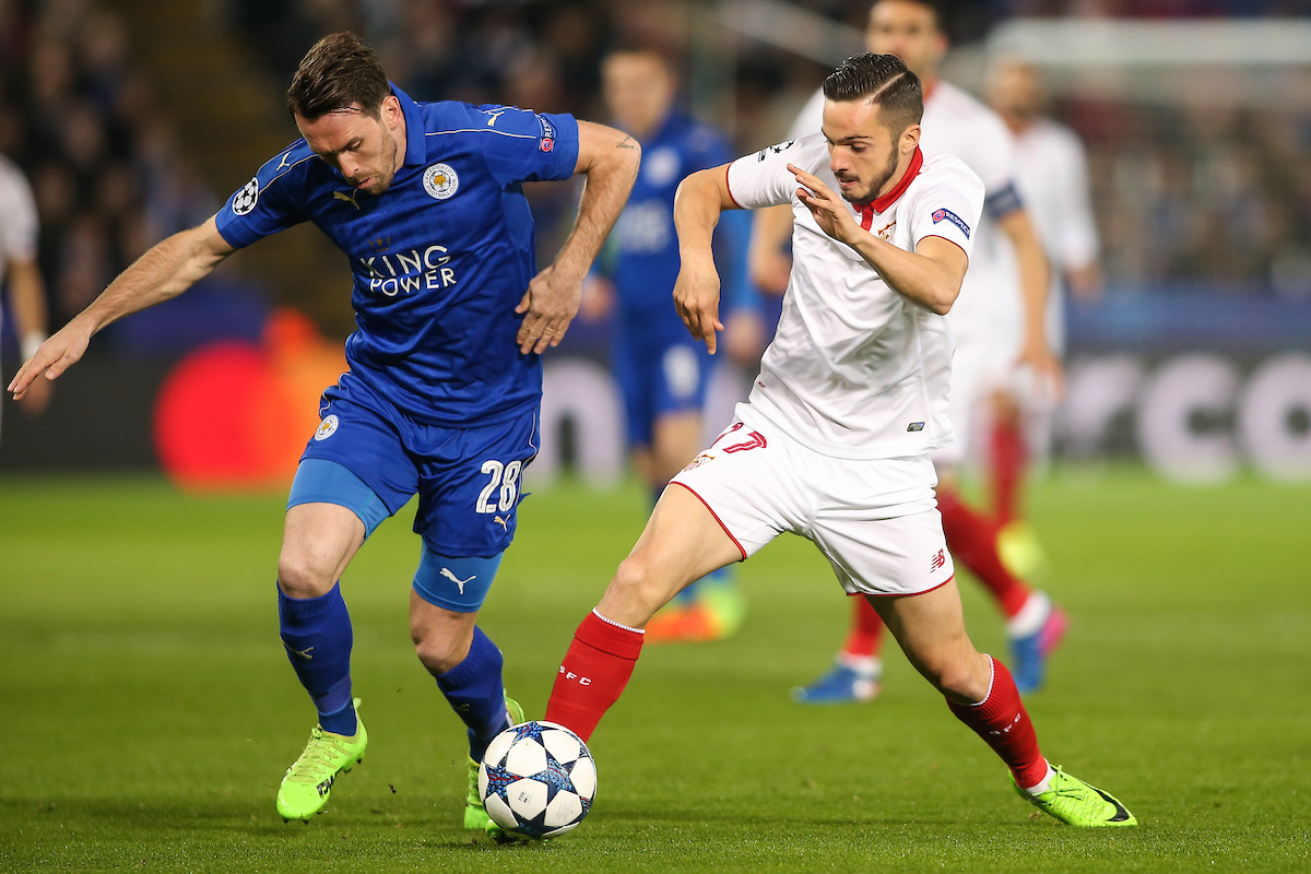 Christian Fuchs of Leicester City (left) competing with Pablo Sarabia of Sevilla (right) during the UEFA Champions League match at the King Power Stadium, Leicester Picture by Andy Kearns/Focus Images Ltd 0781 864 4264 14/03/2017