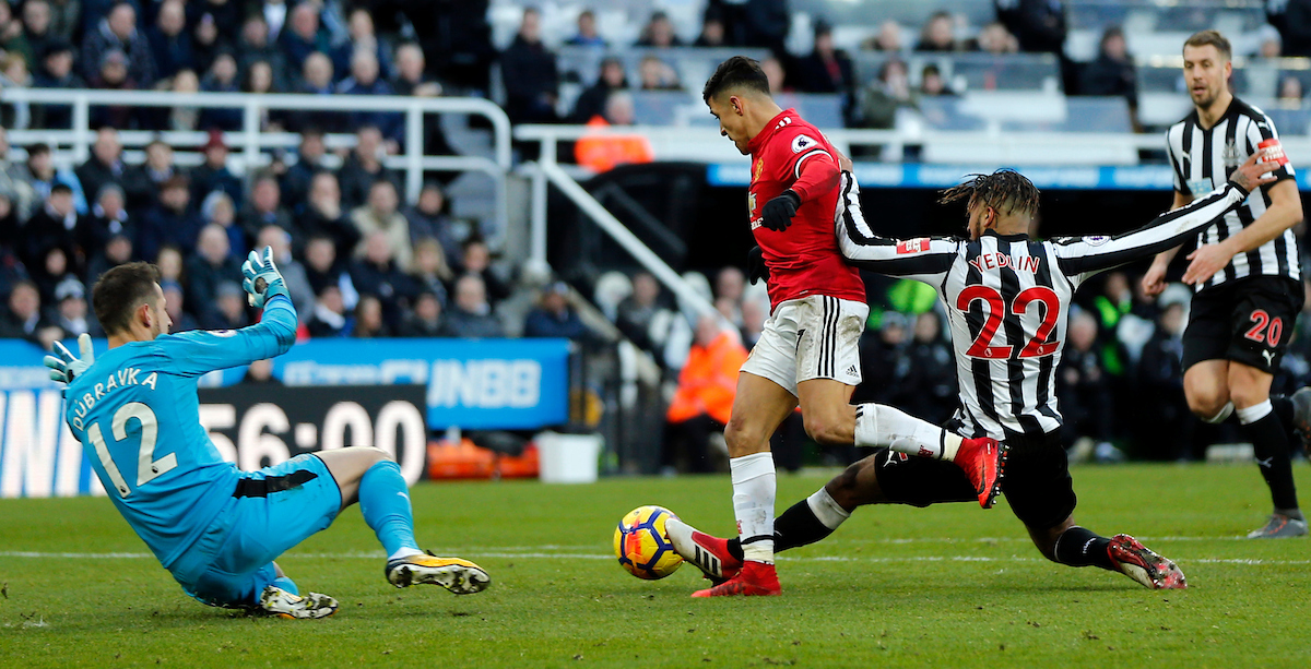 Martin Dubravka (l) and DeAndre Yedlin (r) of Newcastle United and Alexis Sanchez (c) of Manchester United during the Premier League match at St. James's Park, Newcastle Picture by Simon Moore/Focus Images Ltd 07807 671782 11/02/2018