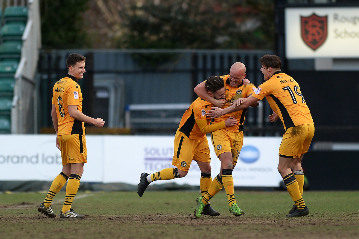 Josh Sheehan of Newport County (2nd left) scores his sides first goal to make the scoreline 1-0 during the Sky Bet League 2 match between Newport County and Colchester United at Rodney Parade, Newport Picture by Richard Blaxall/Focus Images Ltd +44 7853 364624 14/01/2017
