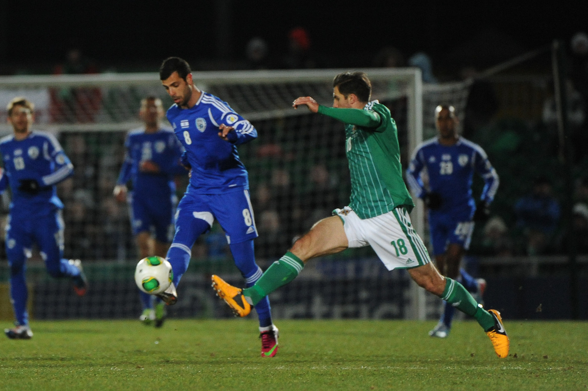 Picture by Ramsey Cardy/Focus Images Ltd +44 7809 235323.26/03/2013.Aaron Hughes of Northern Ireland and Eden Ben Basat of Israel during the 2014 FIFA World Cup Qualifying match at Windsor Park, Belfast.