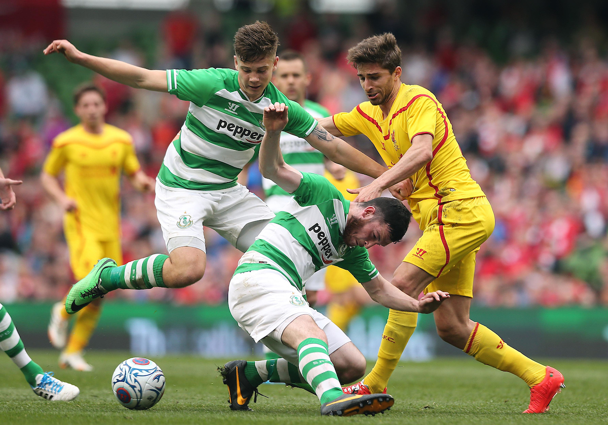 Luke Byrne and Ryan Brennan of Shamrock Rovers tackle Fabio Borini of Liverpool during the Friendly match at the Aviva Stadium, Dublin Picture by Lorraine O'Sullivan/Focus Images Ltd +353 872341584 14/05/2014