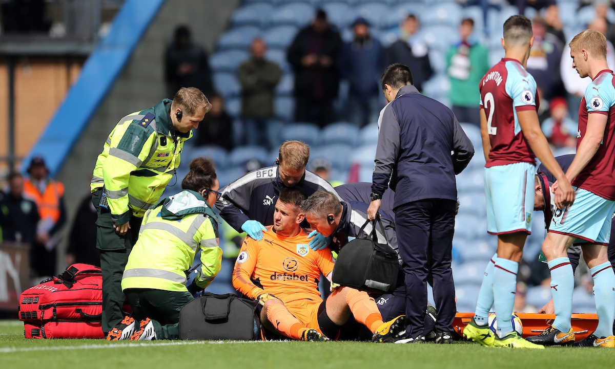 Thomas Heaton (orange top) of Burnley receives treatment during the Premier League match at Turf Moor, Burnley Picture by Simon Moore/Focus Images Ltd 07807 671782 10/09/2017