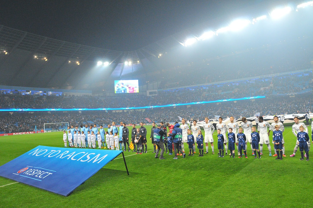 "Manchester City (left) and CSKA Moscow players line up behind ""NO TO RACISM"" banner prior to the UEFA Champions League match at the Etihad Stadium, Manchester Picture by Greg Kwasnik/Focus Images Ltd +44 7902 021456 05/11/2014"