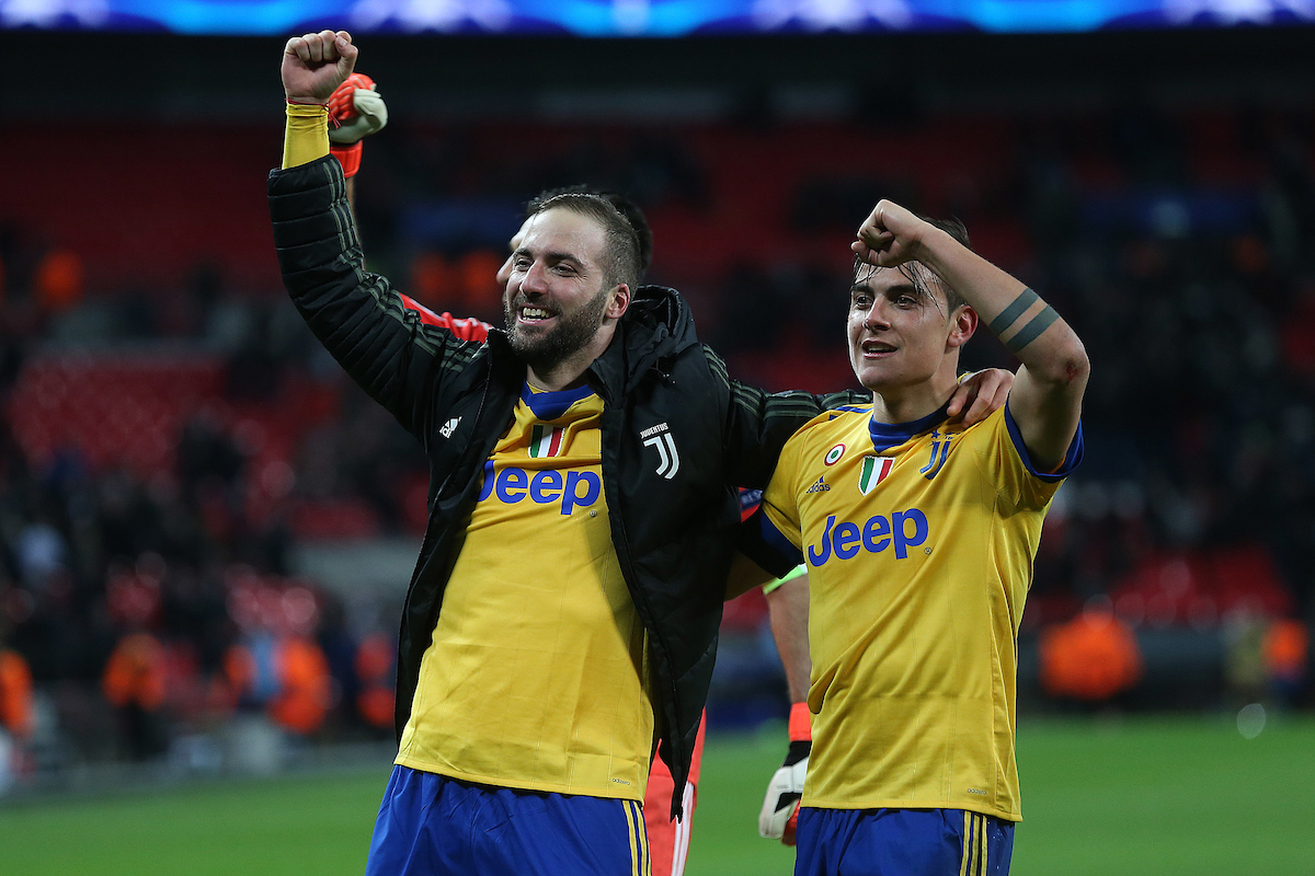 Paulo Dybala of Juventus and Gonzalo Higuain of Juventus celebrate victory at the end of the UEFA Champions League match at Wembley Stadium, London Picture by Paul Chesterton/Focus Images Ltd +44 7904 640267 06/03/2018