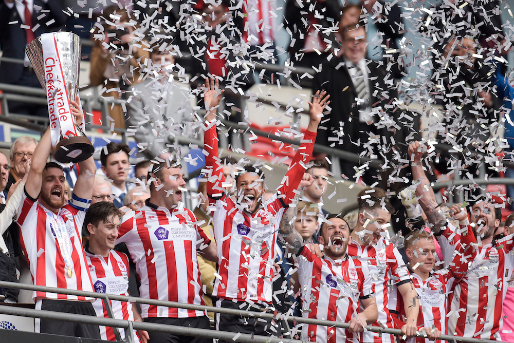 Luke Waterfall of Lincoln City (L) lifts the Checkatrade Trophy after beating Shrewsbury Town 1-0 in the final at Wembley Stadium, London Picture by Alex Burstow/Focus Images Ltd 07814032530 08/04/2018