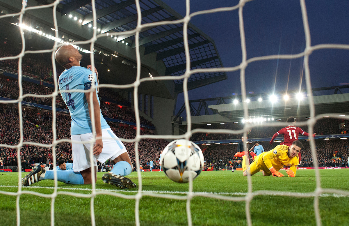 Vincent Kompany of Manchester City (left) and Manchester City goalkeeper Ederson (right) have a look of dejection after Mohamed Salah of Liverpool scores his team's 1st goal to make it 1-0 during the UEFA Champions League Quarter Final match at Anfield, Liverpool Picture by Russell Hart/Focus Images Ltd 07791 688 420 04/04/2018