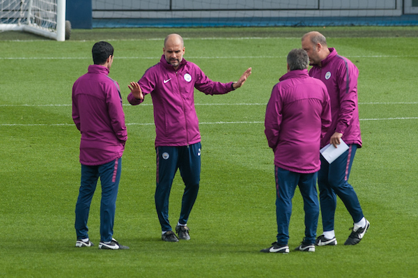 Manchester City manager Josep Guardiola chats with coaching staff during the Manchester City training session at City Football Academy, Manchester Picture by Matt Wilkinson/Focus Images Ltd 07814 960751 09/04/2018