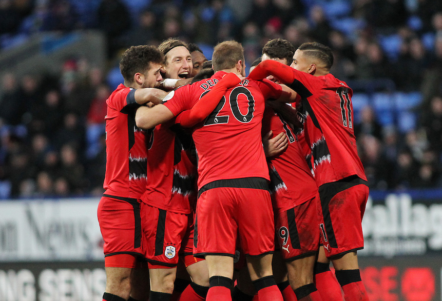 Daniel Williams of Huddersfield Town (in middle of the huddle) celebrates with his team mates after scoring the second goal against Bolton Wanderers during the Third Round FA Cup match at the Macron Stadium, Bolton. Picture by Michael Sedgwick/Focus Images Ltd +44 7900 363072 06/01/2018