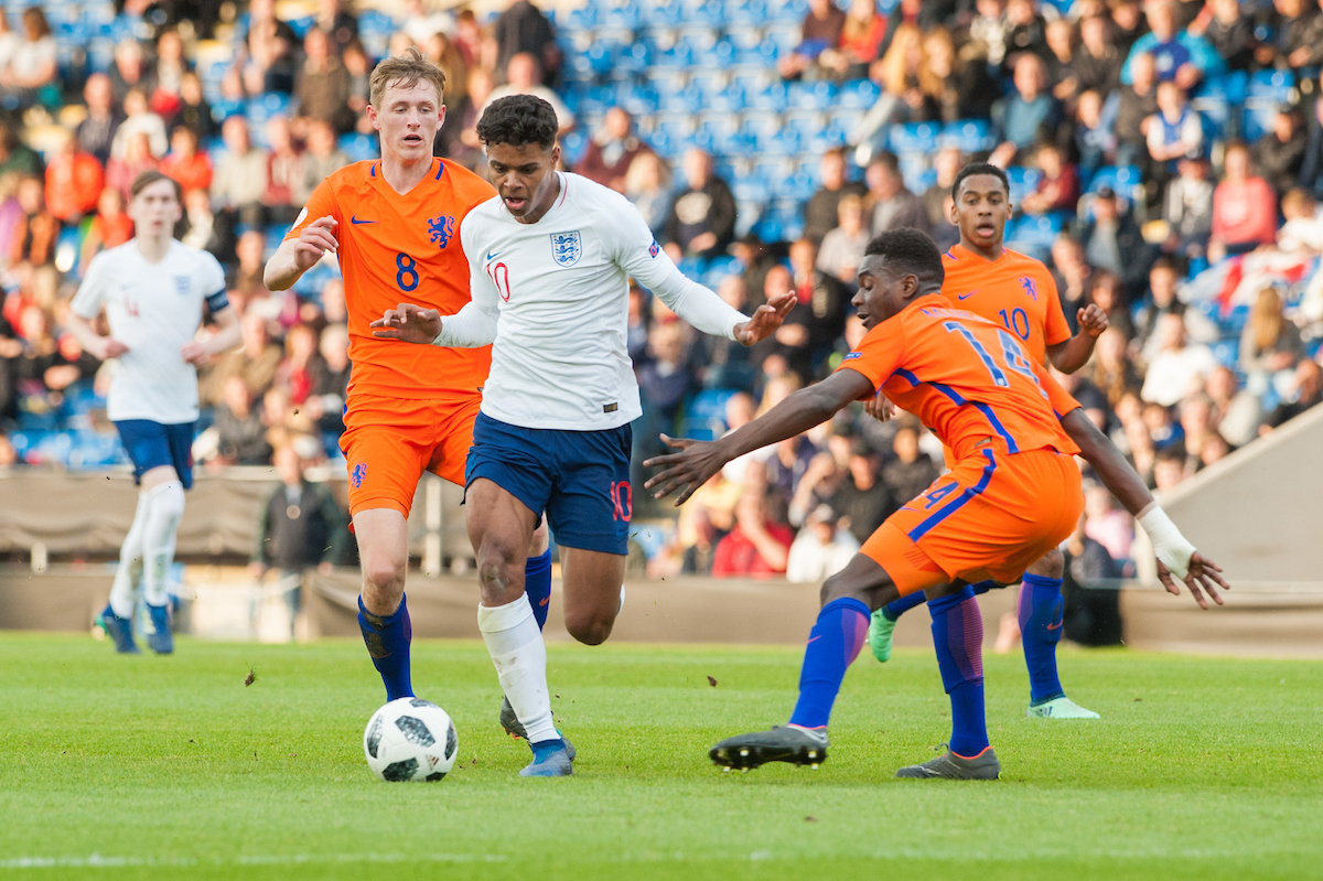 Faustino Anjorin of England tries to find a way past Wouter Burger (left) and Cristopher Mamengi of the Netherlands (right) during the UEFA Euro U17 Championship Semi-Final match at the Proact stadium, Chesterfield Picture by Matt Wilkinson/Focus Images Ltd 07814 960751 17/05/2018