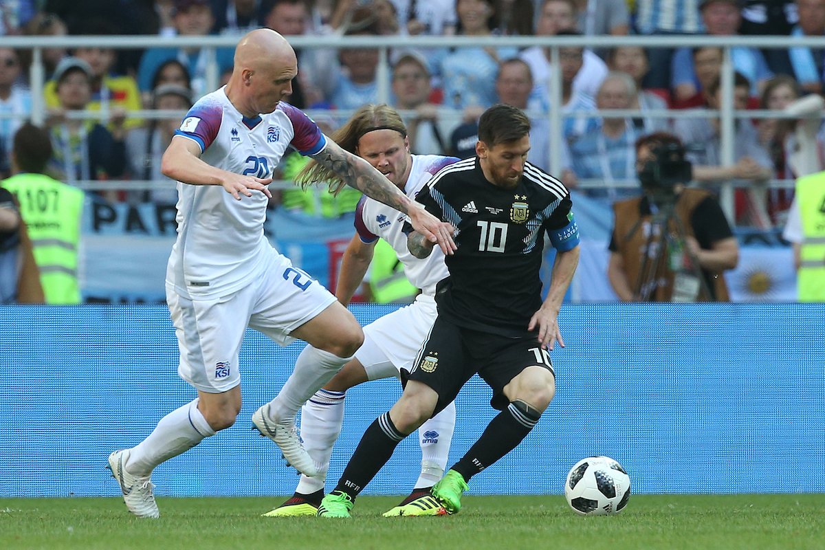 Hordur Magnusson of Iceland, Emil Hallfredsson of Iceland and Lionel Messi of Argentina in action during the 2018 FIFA World Cup match at Spartak Stadium, Moscow Picture by Paul Chesterton/Focus Images Ltd +44 7904 640267 16/06/2018