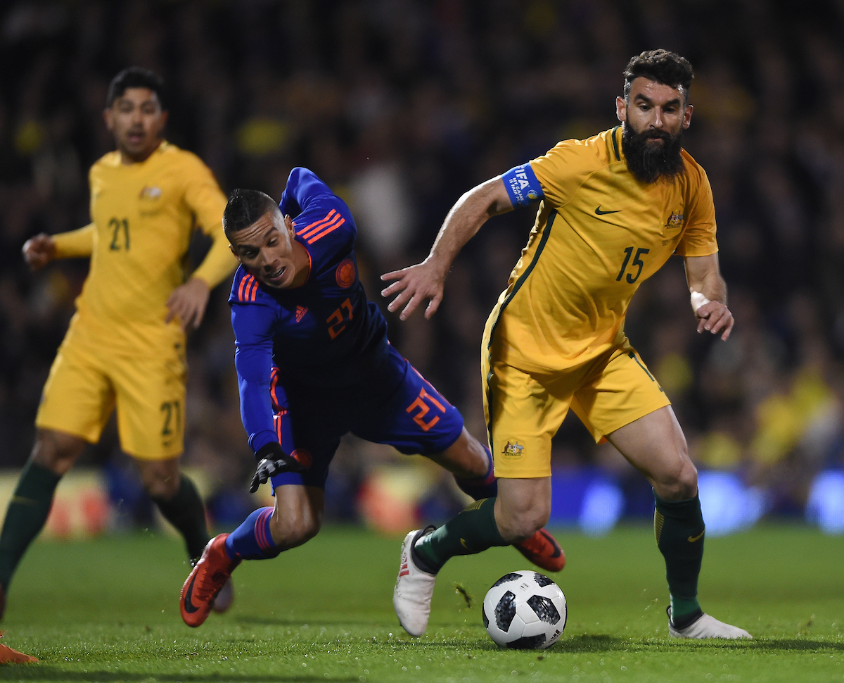 Mile Jedinak of Australia and Johan Mojica of Colombia battle for the ball during the International Friendly match at Craven Cottage, London Picture by Daniel Hambury/Focus Images Ltd 07813022858 27/03/2018
