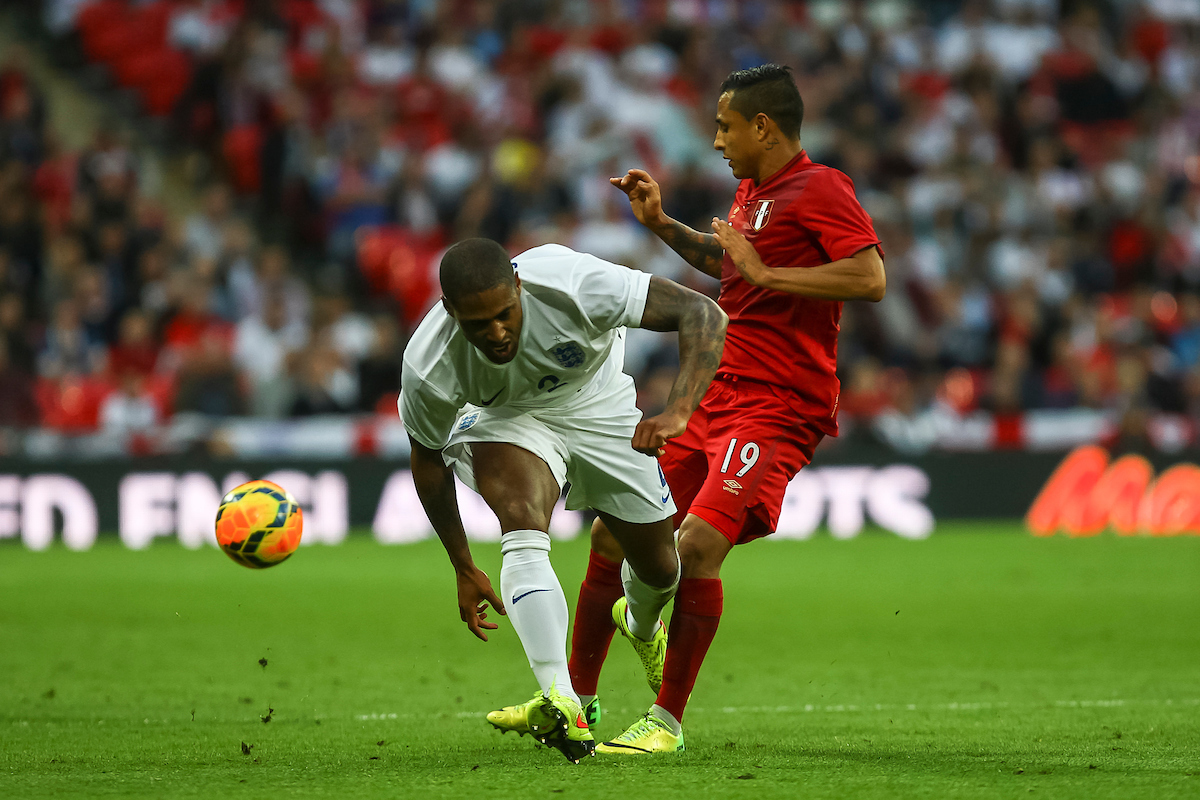Glen Johnson of England and Yoshimar Yotun of Peru compete for the ball during the International Friendly match at Wembley Stadium, London Picture by Daniel Chesterton/Focus Images Ltd +44 7966 018899 30/05/2014