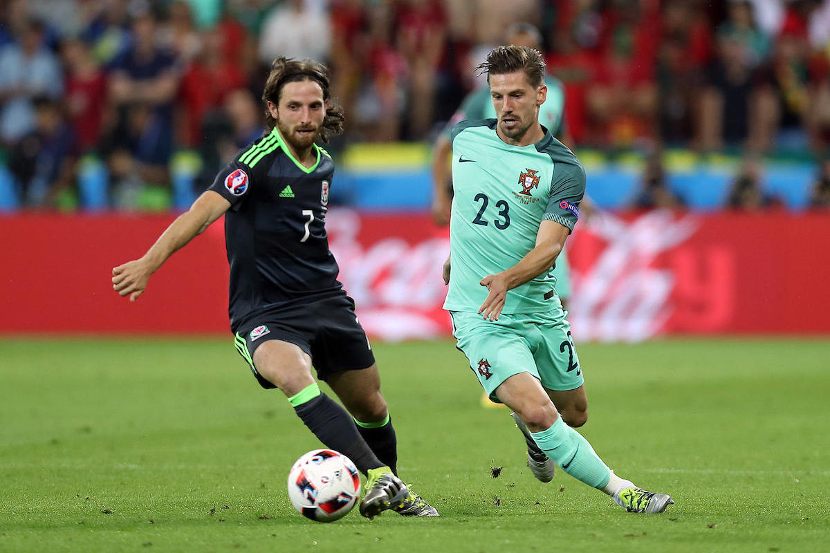 Joe Allen of Wales and Adrien Silva of Portugal in action during the UEFA Euro 2016 semi-final match at Stade de Lyons, Lyons Picture by Paul Chesterton/Focus Images Ltd +44 7904 640267 06/07/2016