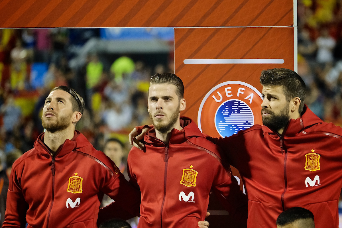 Gerard Piqué of Spain (right) looks at Sergio Ramos of Spain (left) and David de Gea of Spain (centre) during the national anthem pictured ahead of the 2018 FIFA World Cup Qualifying match at Estadio José Rico Pérez, Alicante, Spain. Picture by Kristian Kane/Focus Images Ltd +44 7814 482222 06/10/2017